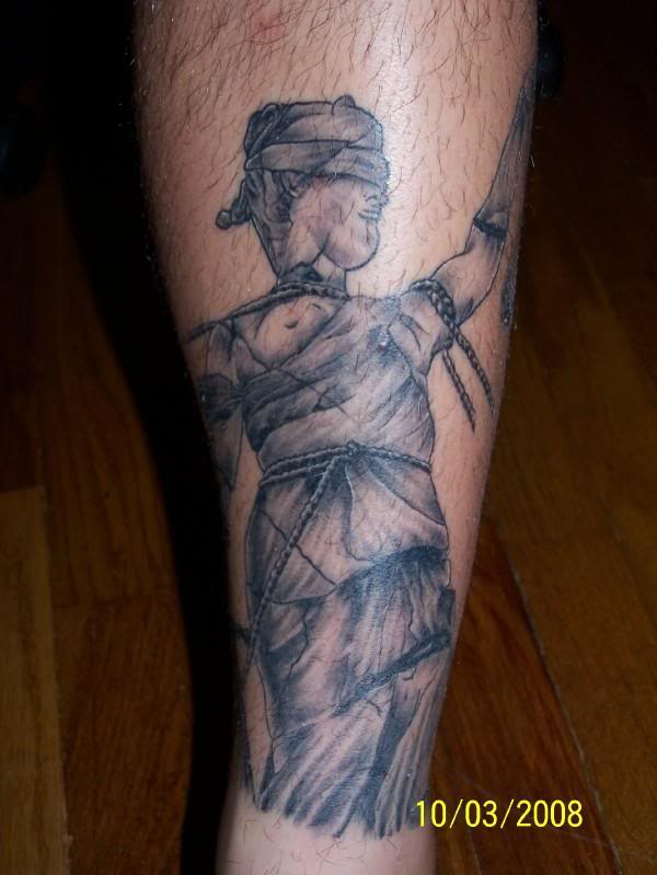 Grey Ink Lady Justice Tattoo On Leg