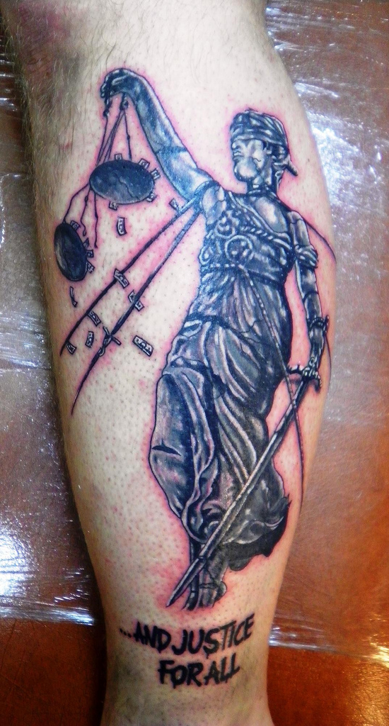 Justice For All Tattoo On Leg