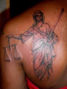 Justice Tattoo On Left Back Shoulder