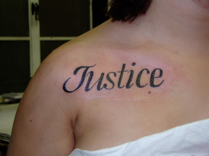 Justice Tattoo On Right Shoulder