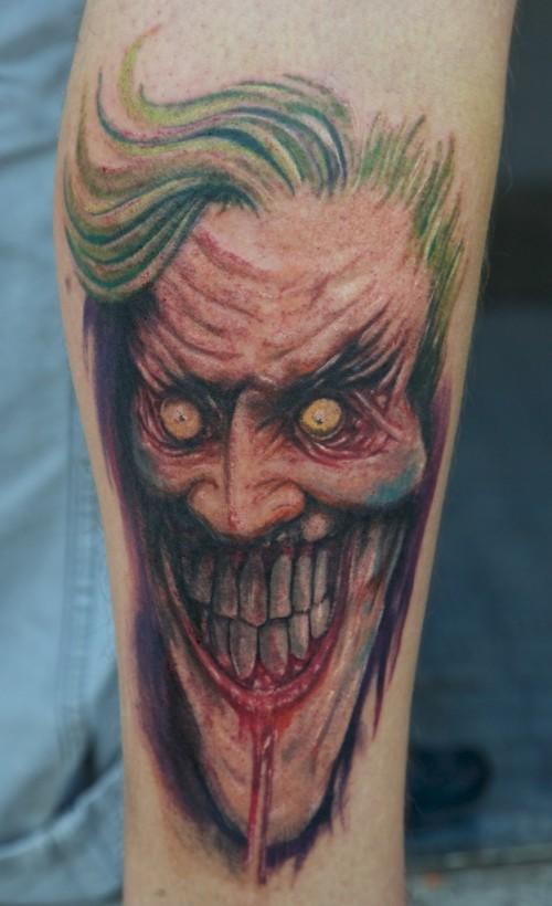 465511a38 Bleeding Face Jester Tattoo On Sleeve
