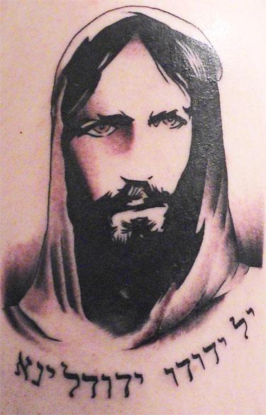 Black Ink Jesus Head Tattoo