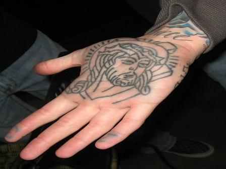 Jesus Head Tattoo on Palm