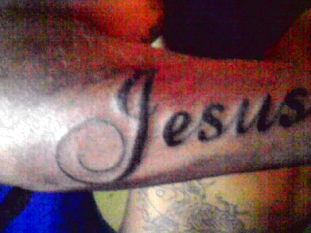 Jesus Name Tattoo On Right Arm