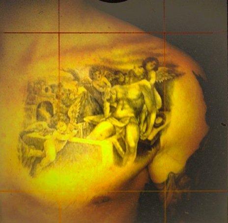 Jesus Tattoo On Left Collarbone