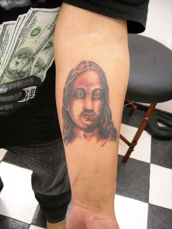 Realistic Grey Ink Cross And Jesus Christ Tattoo On Left Forearm