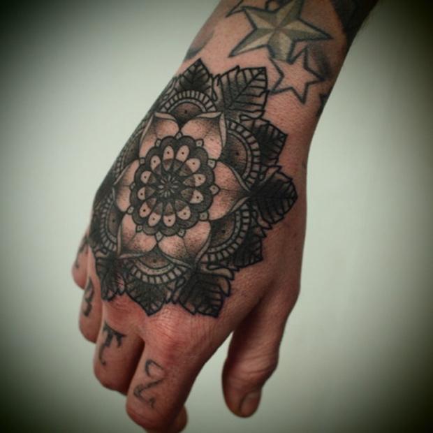 grey ink mandala tattoo on right hand. Black Bedroom Furniture Sets. Home Design Ideas