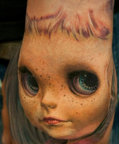 3D Doll Face Tattoo On Left Hand