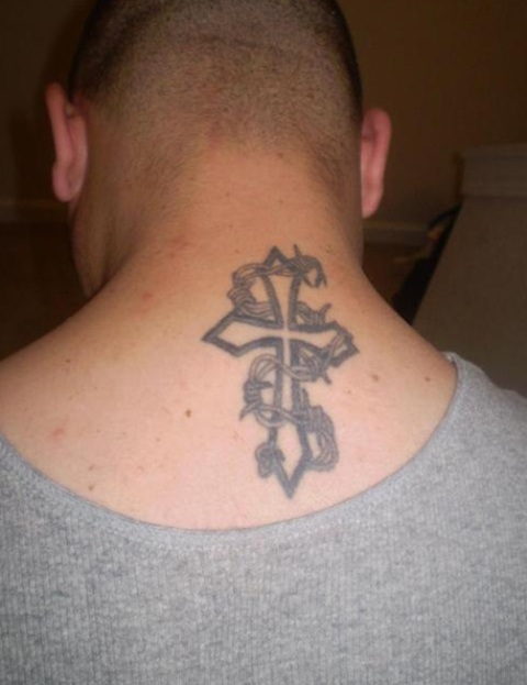 Cross and barbed wire tattoo on upperback