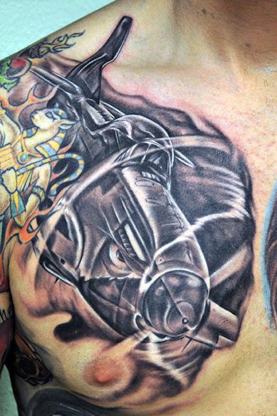 Grey Ink Airplane Tattoo On Man Chest