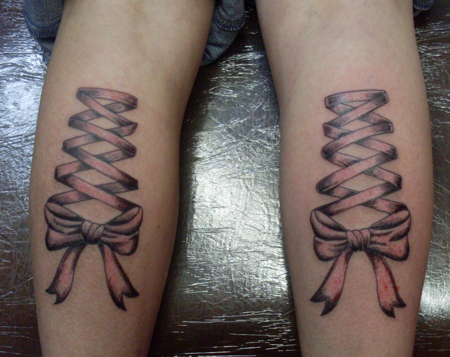 corset bow tattoos on back legs for