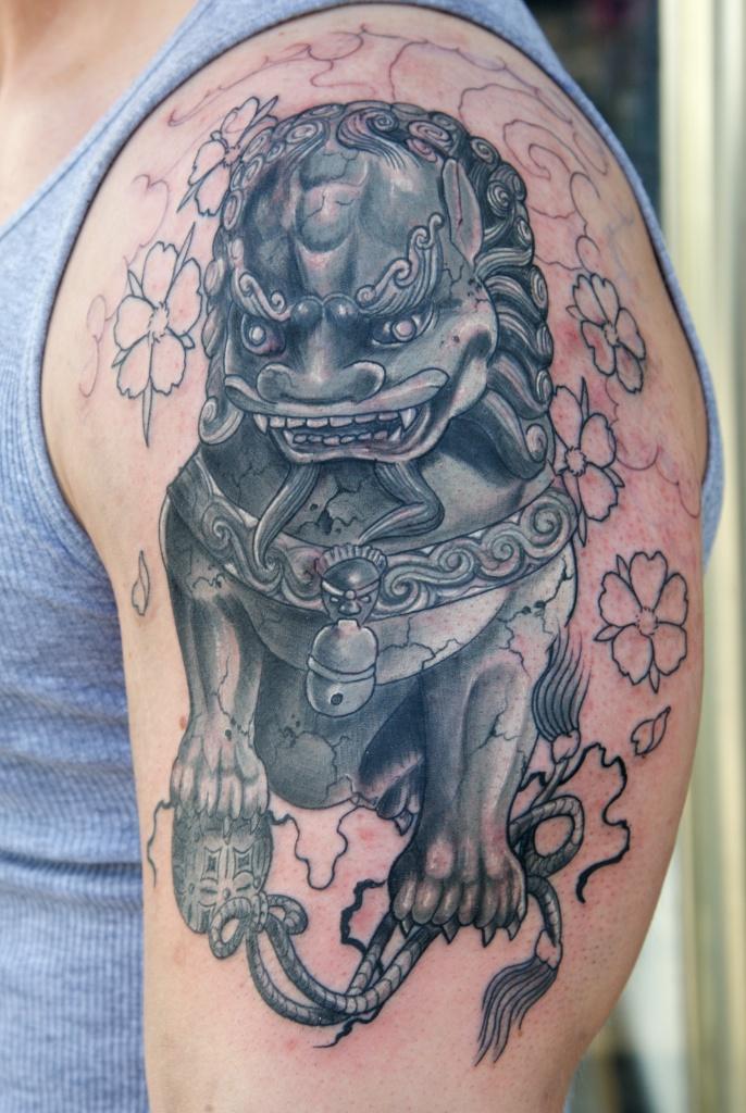 Grey Ink Foo Dog Tattoo On Left Half Sleeve