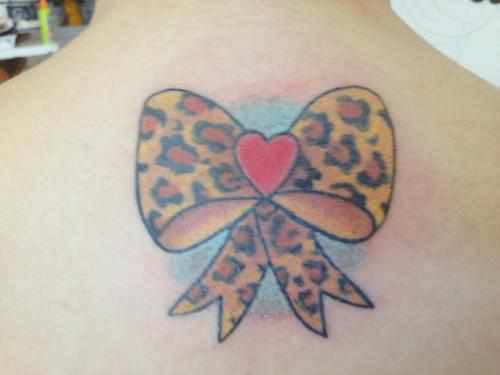 leopard print bow tattoo on side rh tattoostime com Pink Leopard Print Tattoos leopard print bow tattoo designs