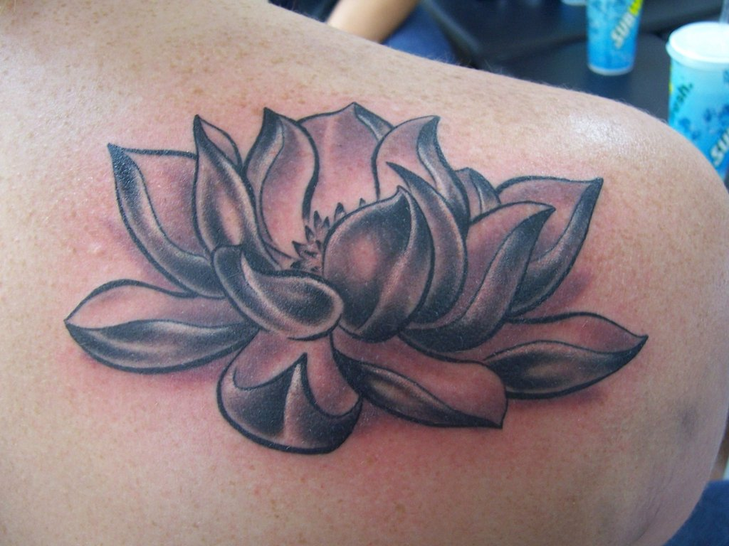 Awesome grey ink lotus tattoo on right back shoulder izmirmasajfo Choice Image