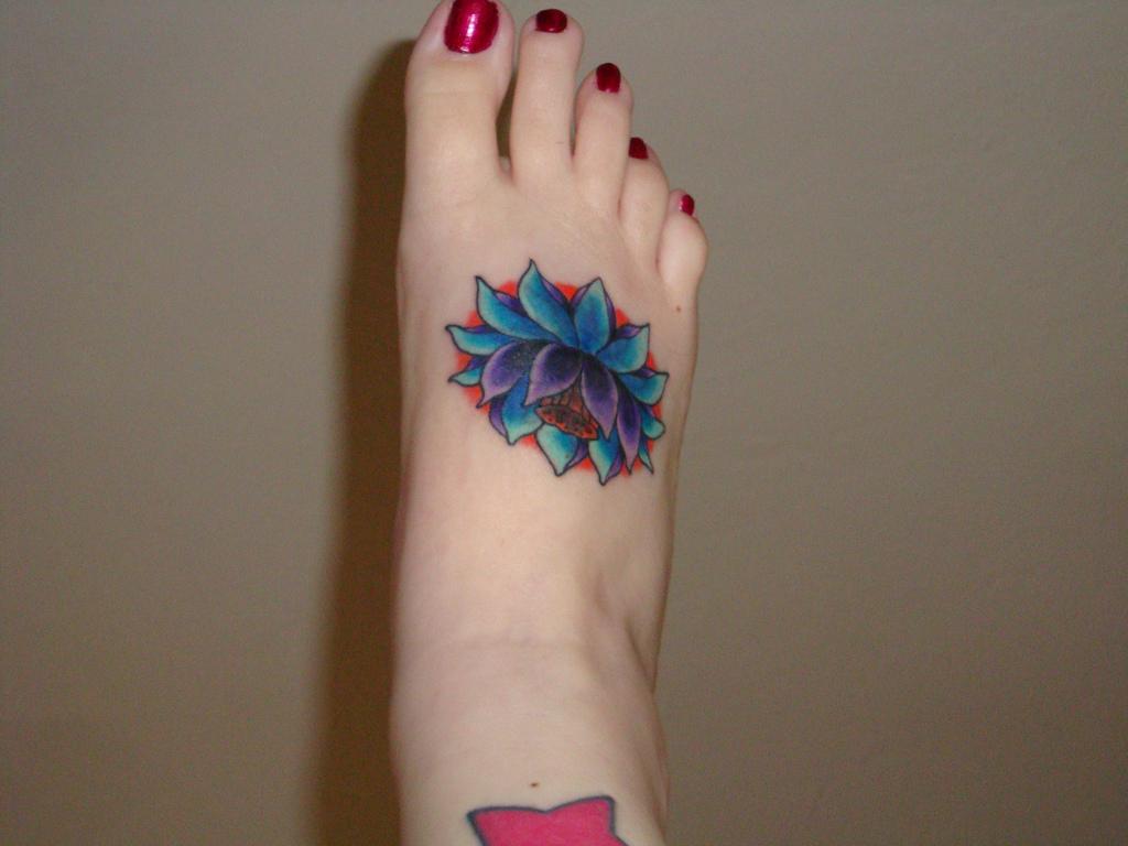 Blue Lotus Flower Tattoo On Side Rib
