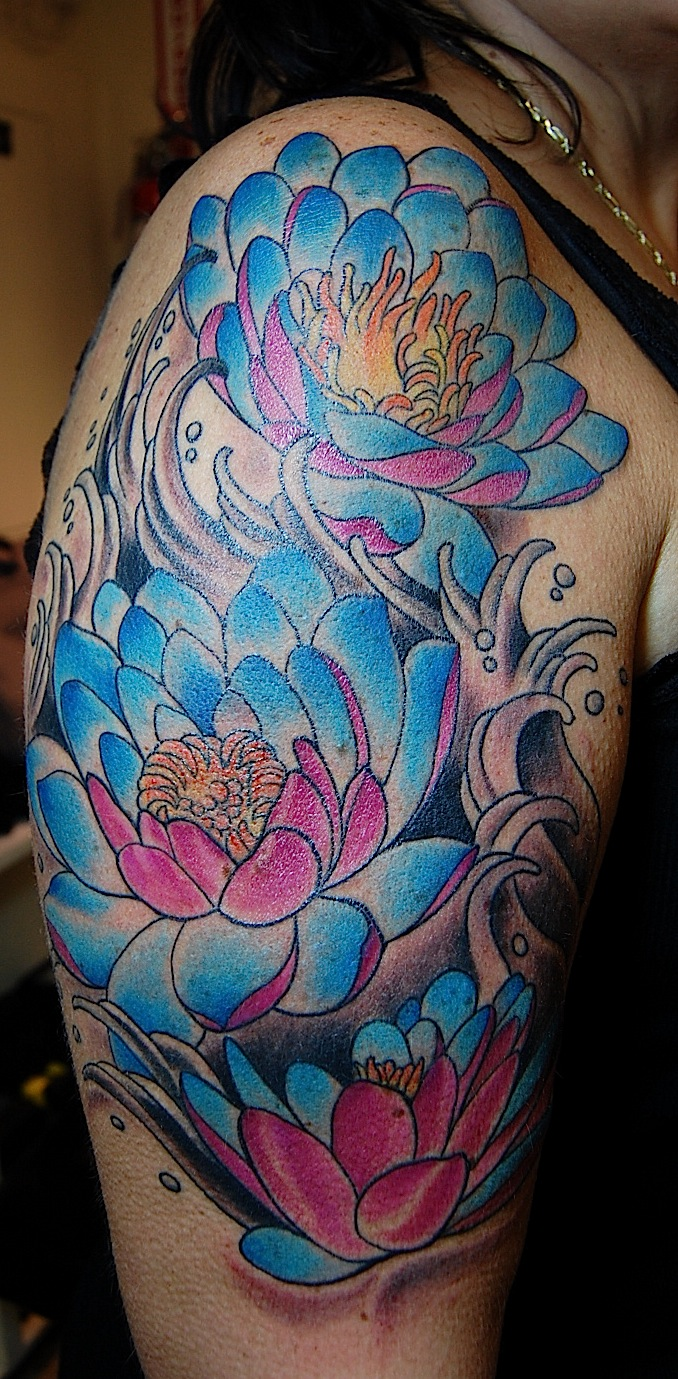Blue Lotus Flowers Tattoos On Right Half Sleeve