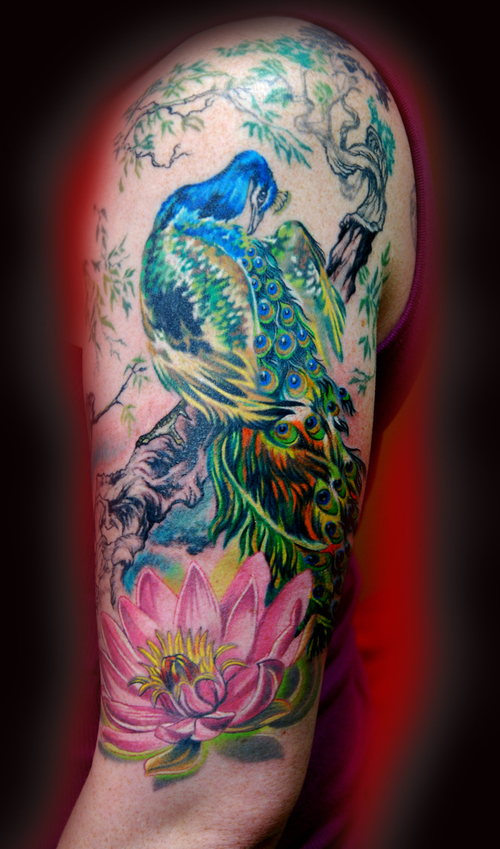 Color Ink Peacock With Lotus Flower Tattoo On Sleeve