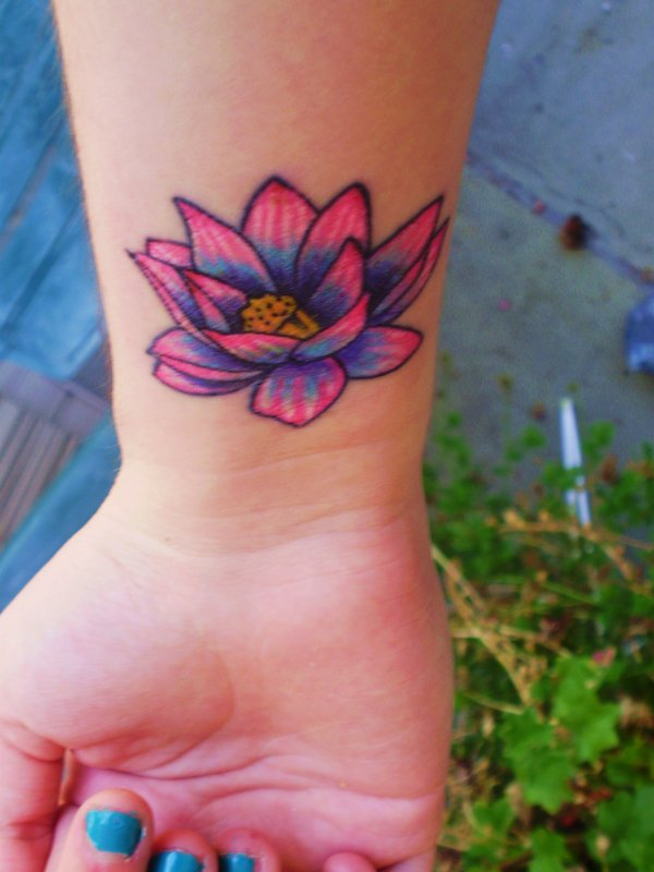 Color Lotus Flower Tattoo On Girl Right Wrist