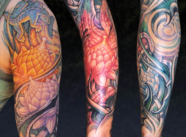 Colored lotus flower tattoo on man chest and left half sleeve colored lotus flower tattoos on sleeve mightylinksfo