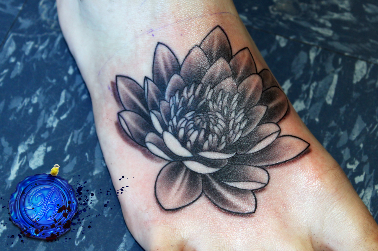 Grey Ink Lotus Tattoo On Right Foot