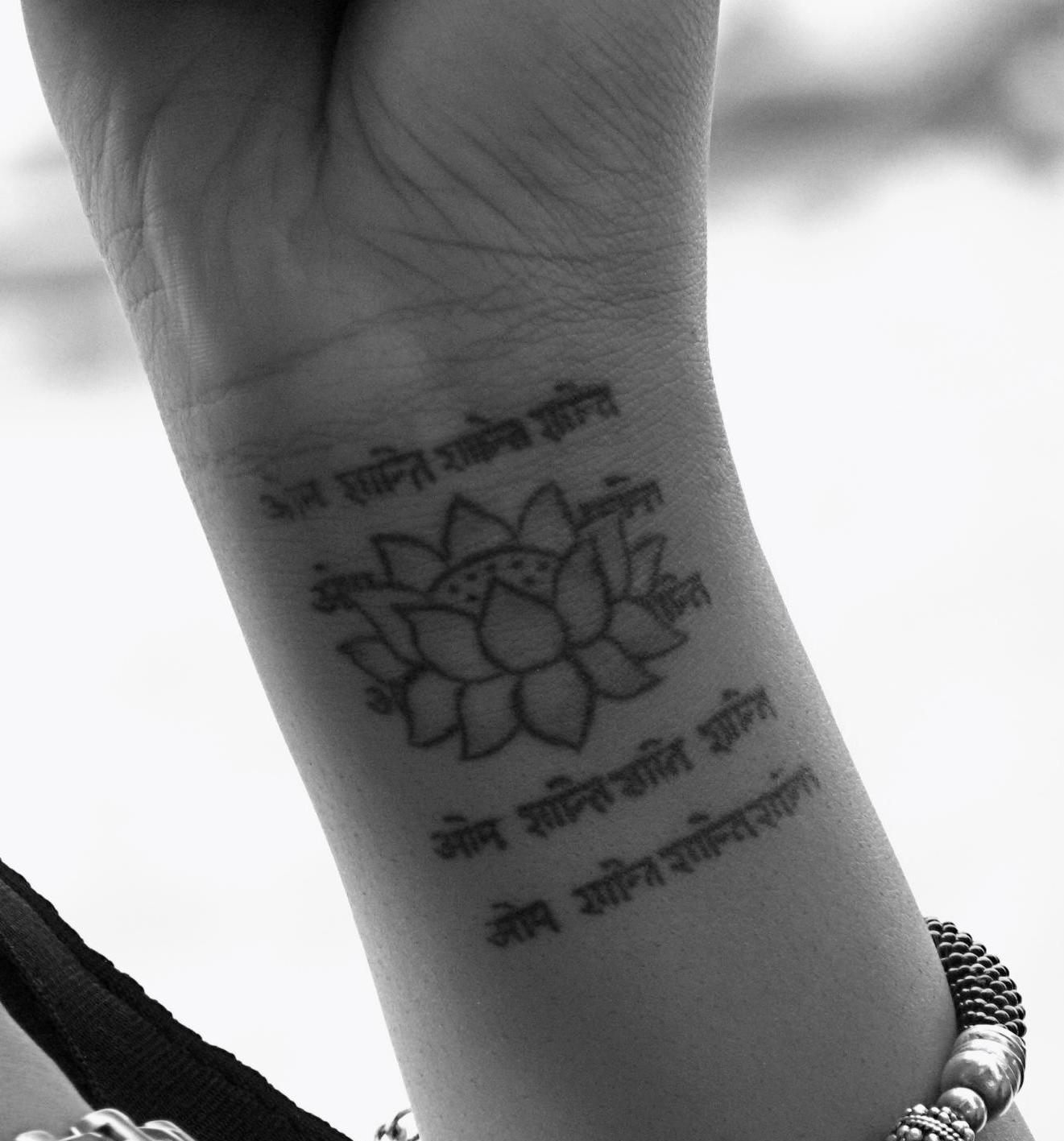Small Lotus Tattoo On Left Wrist