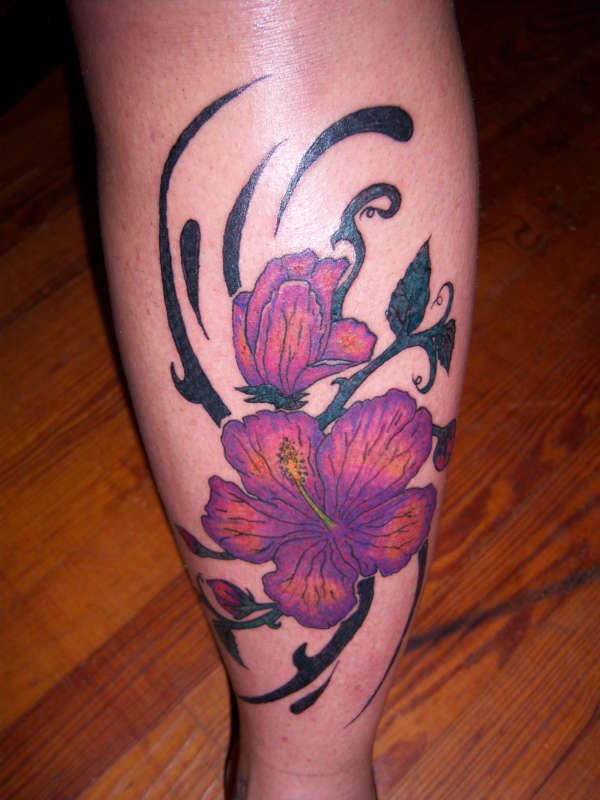 Tribal And Lotus Tattoo On Back Leg