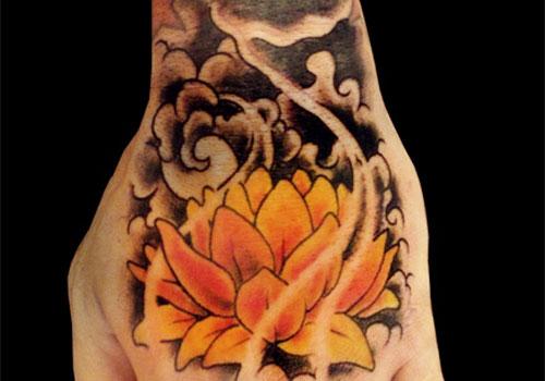 Yellow Lotus Tattoo On Left Hand