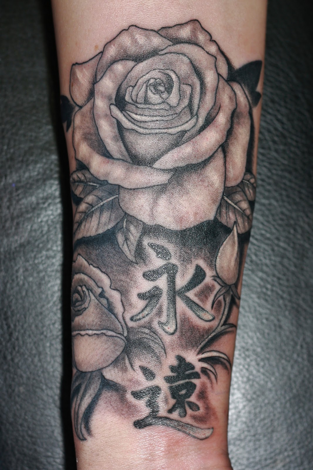 Grey Ink Rose Tattoo On Forearm