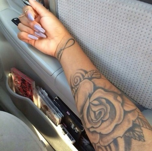 Grey ink rose tattoo on girl right foot