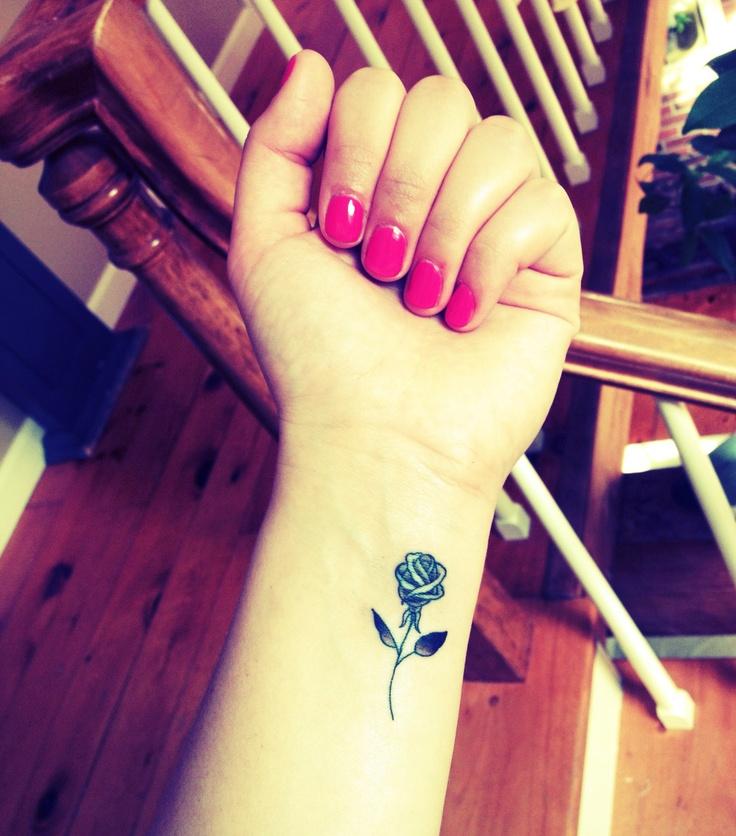 Wonderful Black Rose Tattoo On Left Forearm