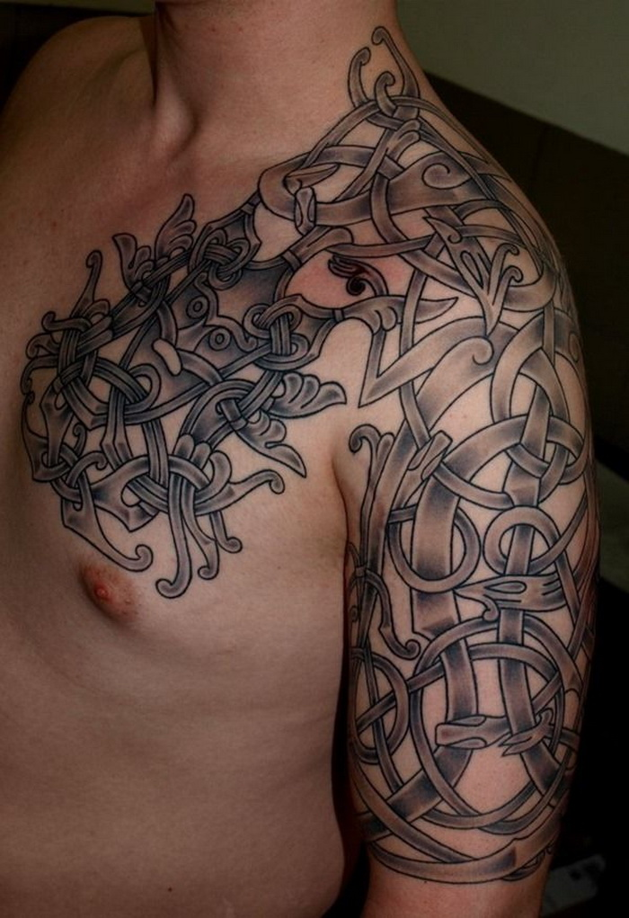 Grey Ink Viking Tattoo On Man Chest And Left Half Sleeve