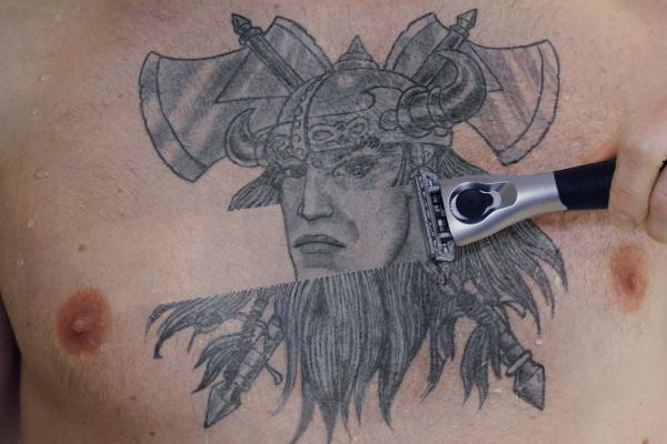 Shaved Viking Tattoo On Chest For Men
