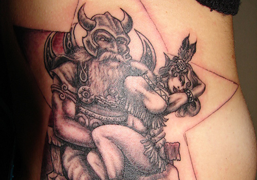 Star And Viking Tattoo On Back