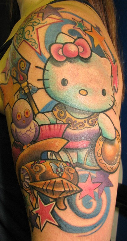 ce7b30637dde2 Colored Candy and Kitty Tattoo On Man Left Half Sleeve