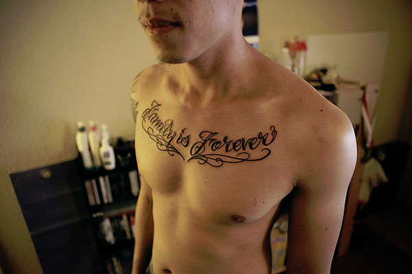 Cool Quote Tattoo On Man Chest