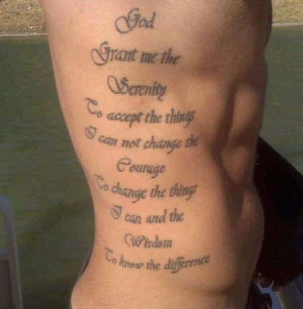 Cool Quote Tattoo On Man Side Rib