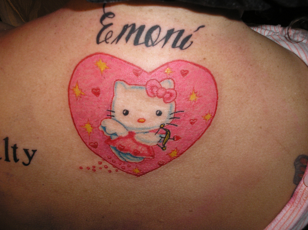 Emoni kitty in pink heart tattoo on back for Pink heart tattoo