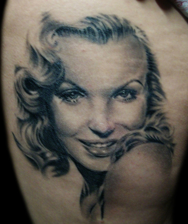 Grey Ink Portrait Tattoo