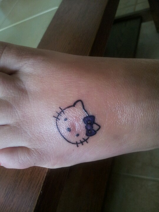 923af1d7e Hello Kitty Head Tattoo On Left Foot