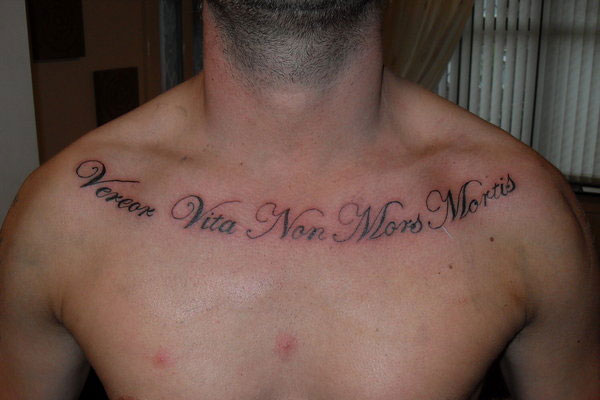 Latin Quote Tattoo On Man Chest