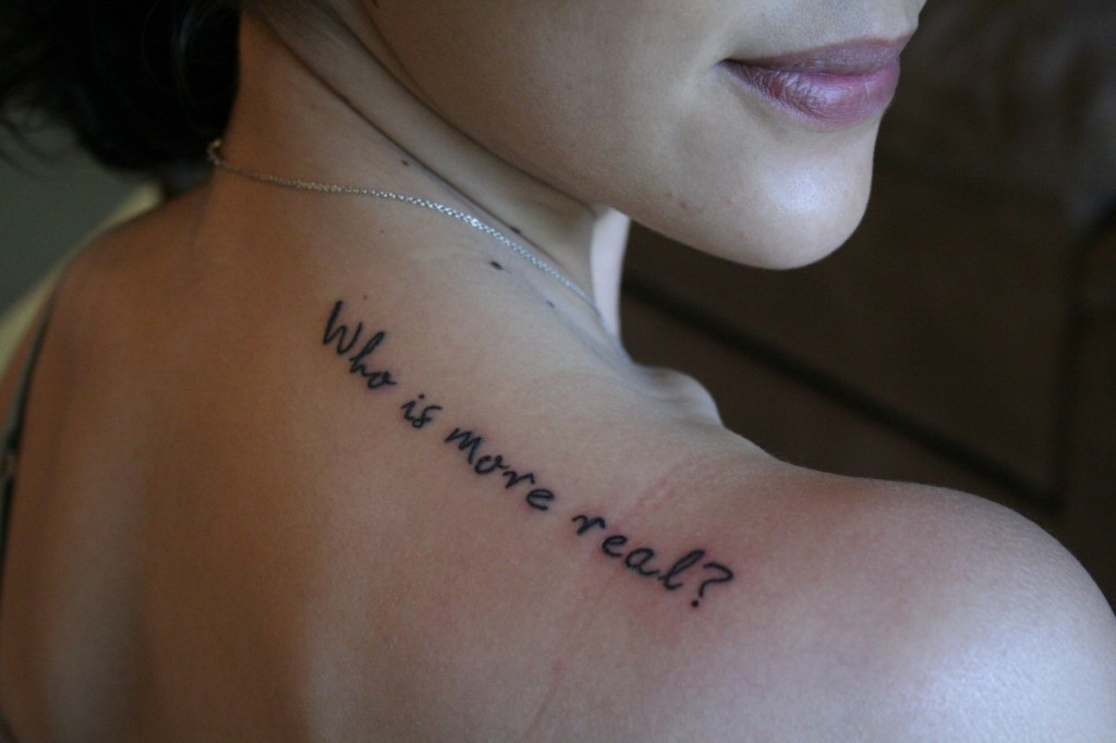 Who Is More Real Quote Tattoo on Right Back Shoulder