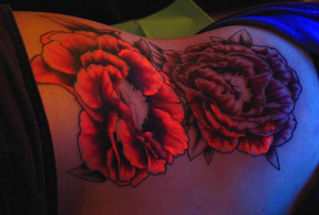 red light flowers tattoo on side rib