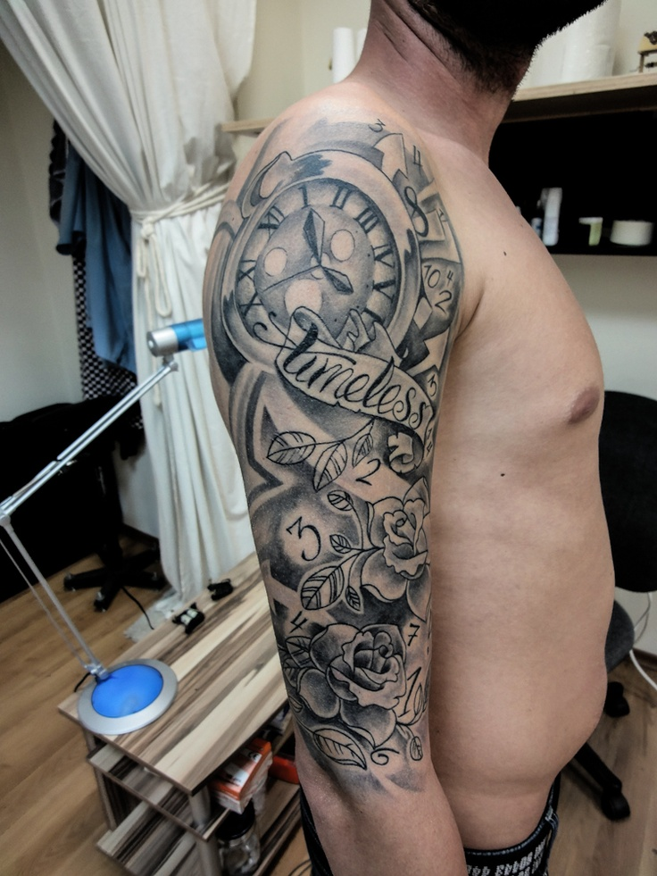 Grey Ink Clock And Punk Tattoo On Right Half Sleeve