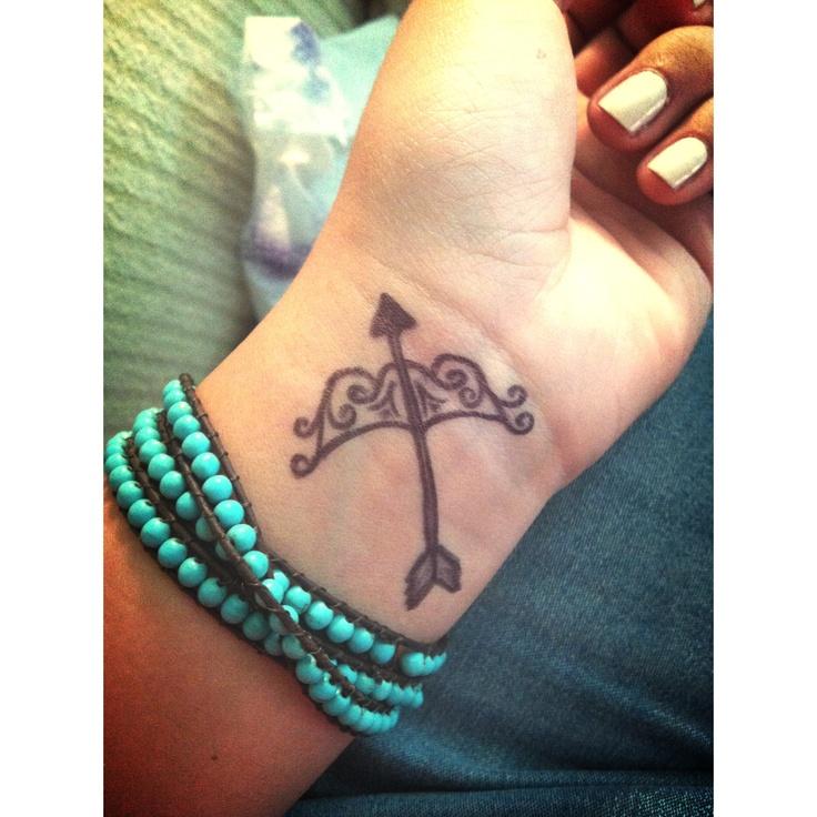 Sagittarius Tattoo On Girl Left Wrist