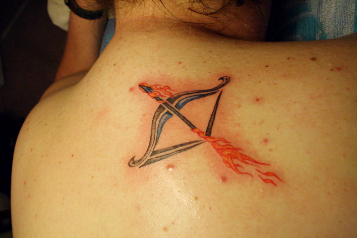 Sagittarius Tattoo On Upperback