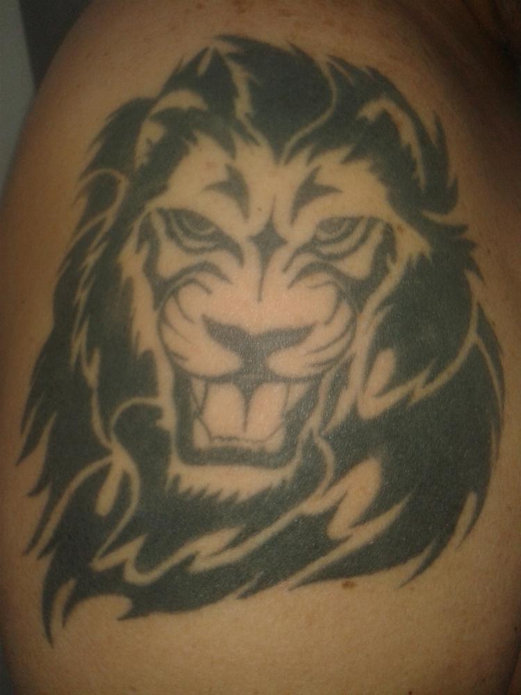 Black Ink Tribal Lion Head Tattoo On Left Shoulder