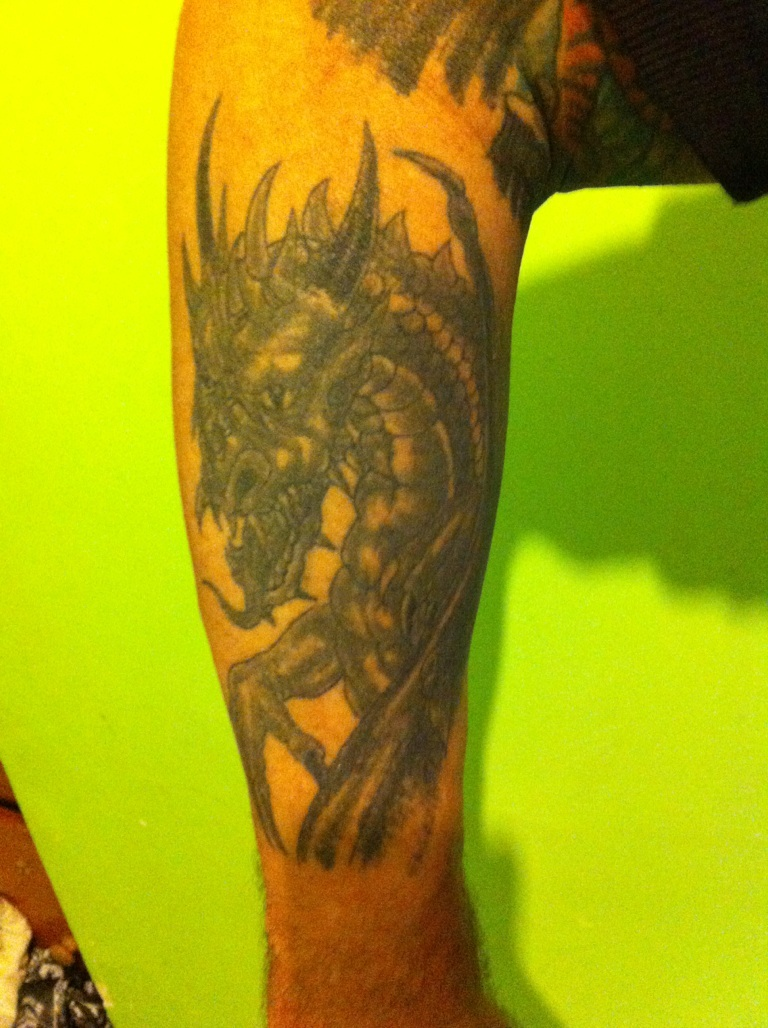 Dragon tattoo images designs for Tattoos on right arm