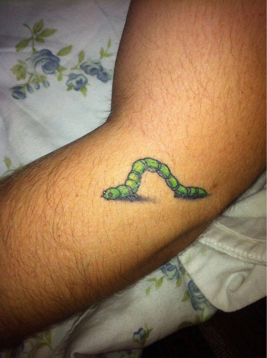 green ink worm tattoo on left sleeve. Black Bedroom Furniture Sets. Home Design Ideas