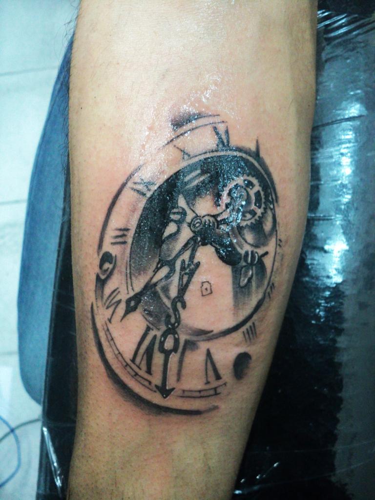 Grey Ink Clock Tattoo On Arm