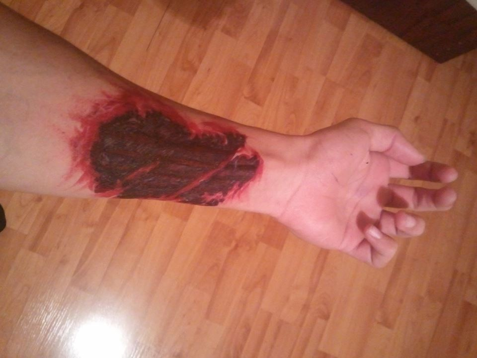 Left Forearm Ripped Skin Tattoo